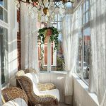 Sunroom, White Wooden Wall, Rattan Chair, Wooden Coffee Table, White Shade, Chandelier