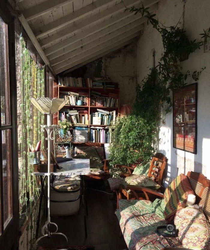 sunroom, wooden floor, white wall, white wooden ceiling, wooden sofa, wooden chair, wooden shelves, floor lamp