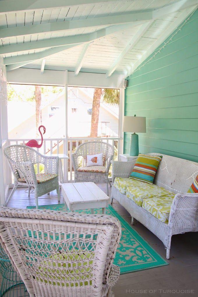 turquoise shiplank, wooden floor, white wooden ceiling, white rattan chairs, white rattan sofa, white wooden coffee table