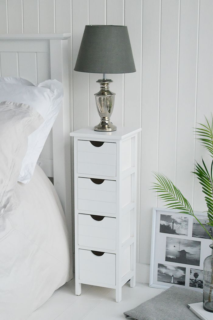 white cabinet with four tier drawers, white wooden wall