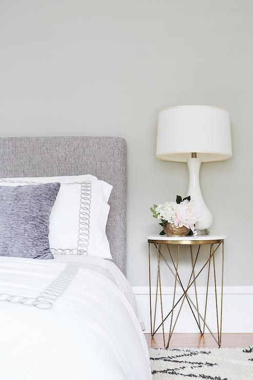 white top table with golden lined legs, white table lamp