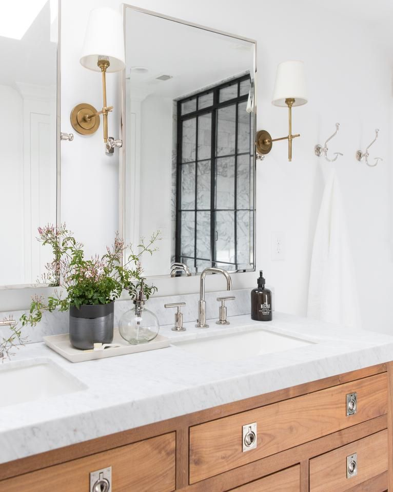 white traditional bathroom sconces with golden line, white wall, white marble