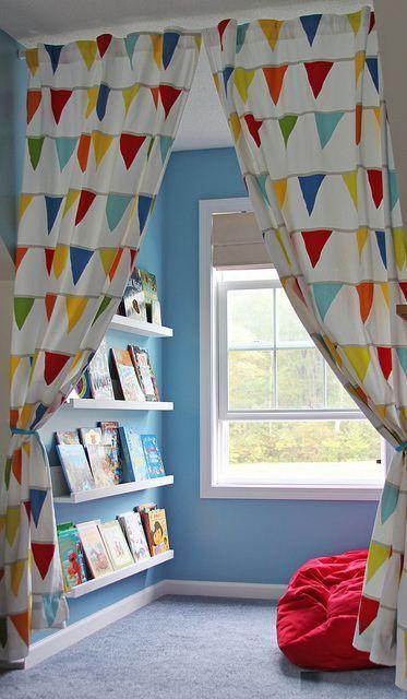 window nook, blue wall, white framed window, white floating shelves