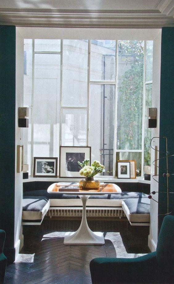 window nook, wooden chevron floor, black floating bench, wooden table, glass window