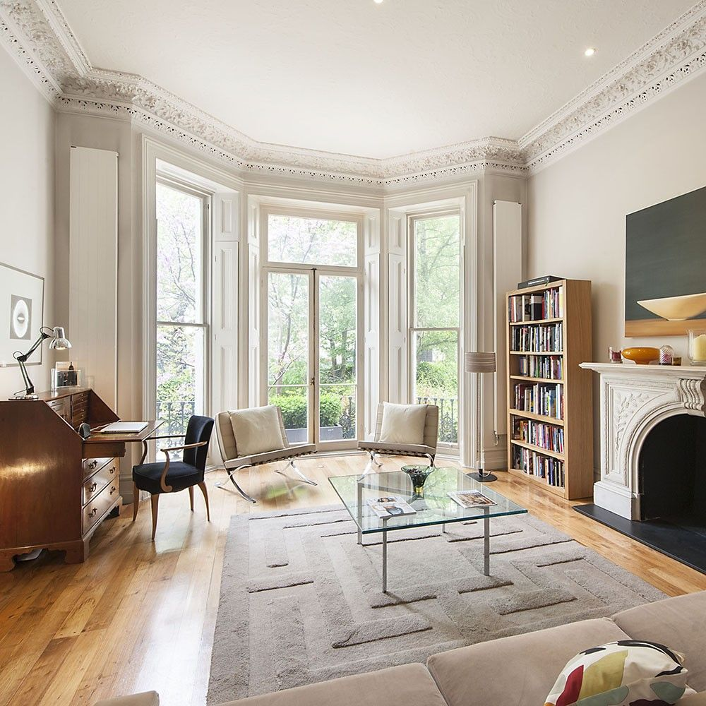 window way, white wall, white framed window, wooden floor, white chairs, white rug, glass coffee table