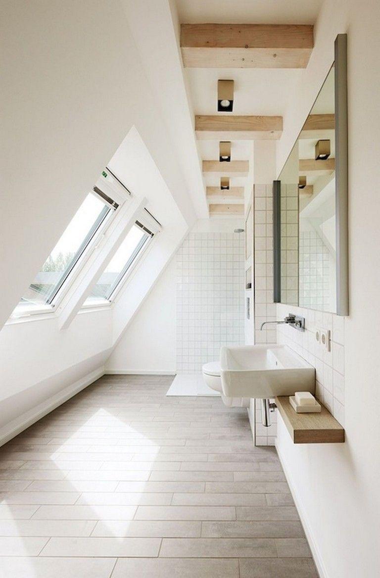 bathroom, brown floor tiles, white wall, white wall tiles, floating vanity, white sink, white toilet