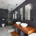 Bathroom, Cream Floor Tiles, Grey Wall, Wooden Floating Vanity, White Sinks, Glass Partition On Showe