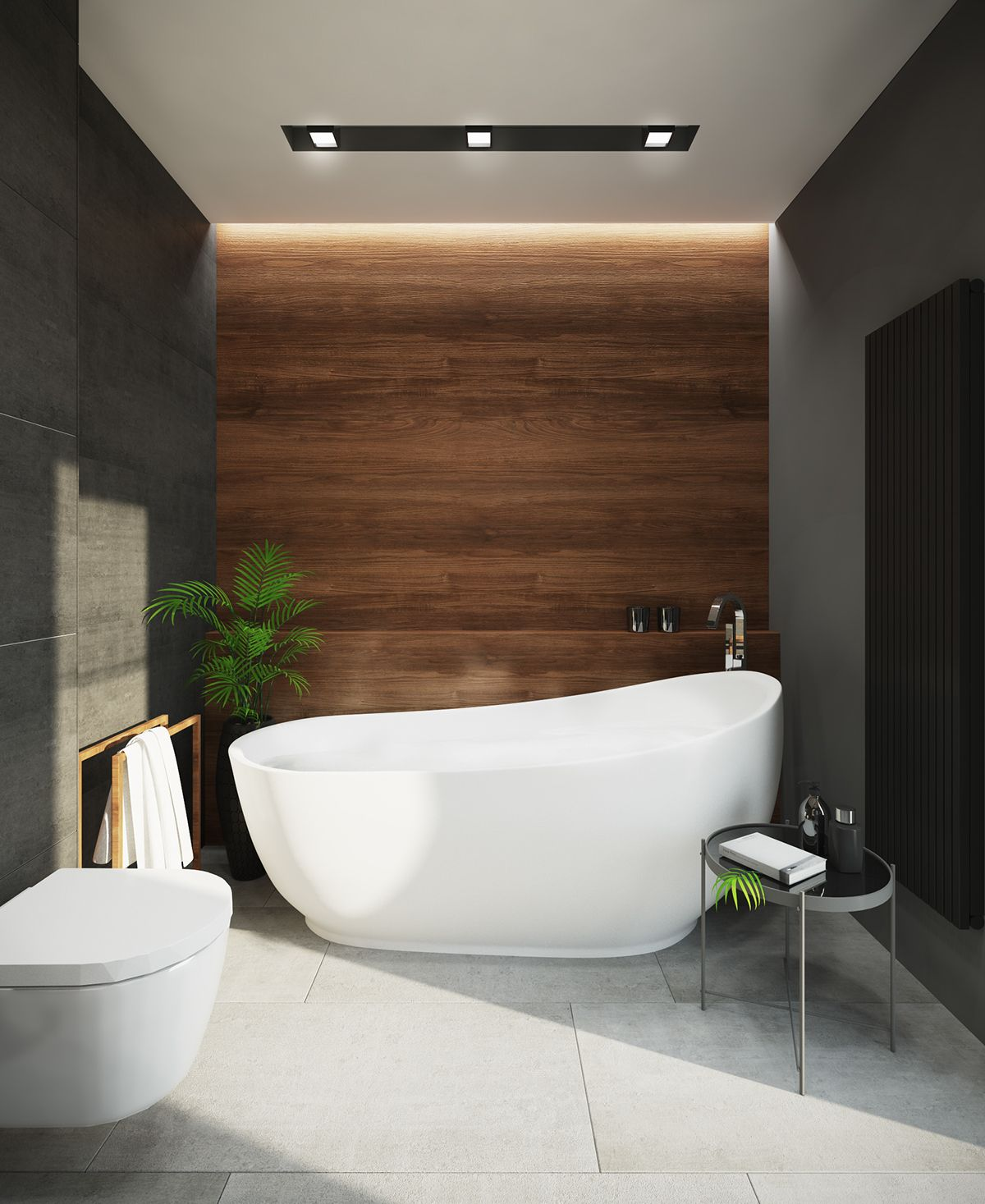 bathroom, grey floor tiles, grey wall tiles, wooden accent wall, white tub, white toilet, side table