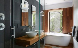 bathroom, grey floor, wooden mat, wooden floating vanity, white sinks, white tub, wooden accent