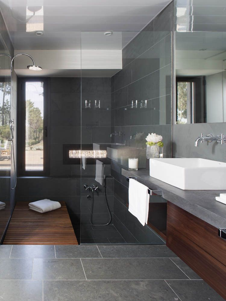bathroom, grey wall, indented tub, wooden floor, grey wall, floating vanity,
