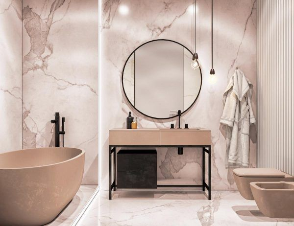 bathroom, soft pink marble wall, round large mirror, pink console vanity table, pink tub, pink toile