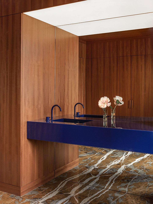 bathroom vanities, brown marble floor tiles, wooden wall, blue floating vanity
