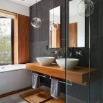 Bathroom, White Floor, Black Wall, ,wooden Accent Wall, White Tub, Wooden Floating Vanity With White Sinks