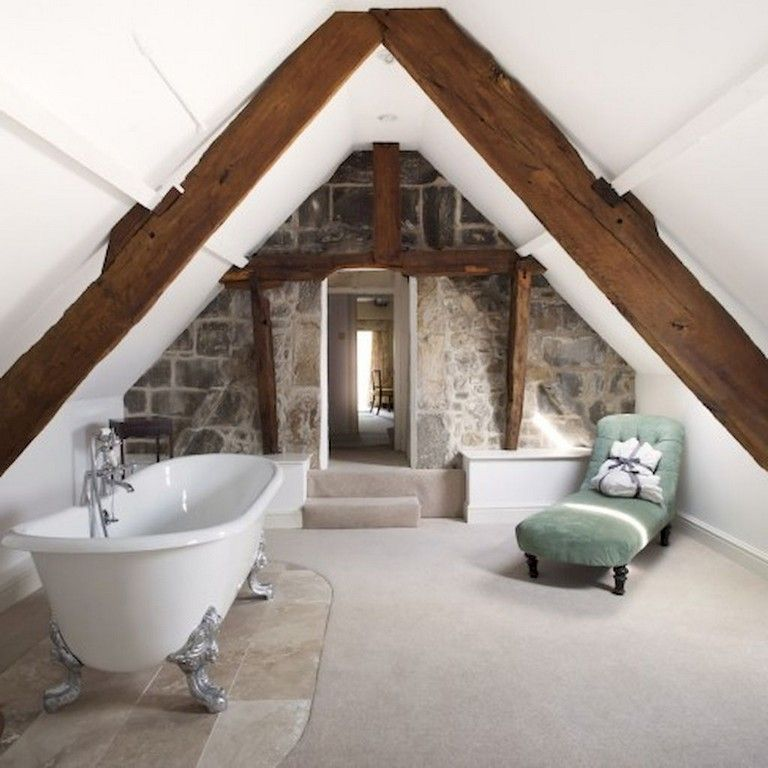 bathroom, white floor, vaulted ceiling, wooden beams, white tub, green lounge chair