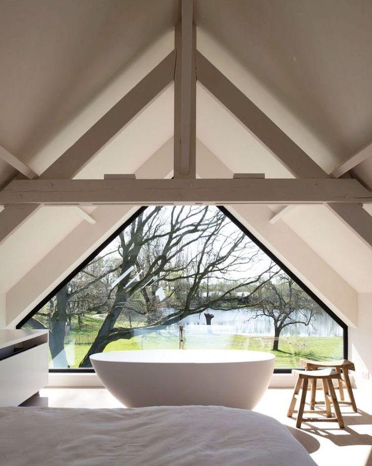 bathroom, white floor, white vaulted ceiling, white tub, wooden stools
