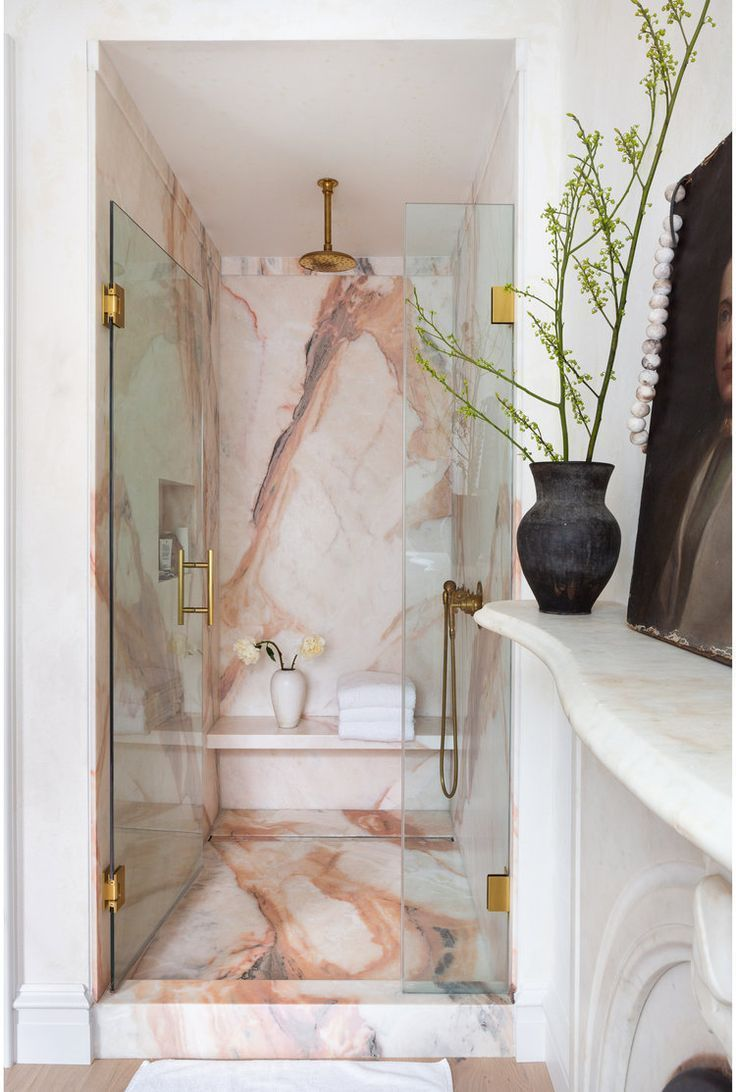 bathroom, white wall, pink marble wall and floor, golden faucet, white marble floating shelves
