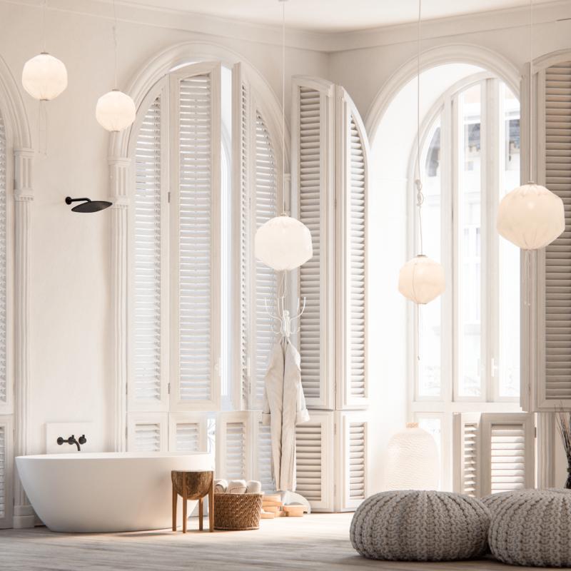 bathroom, white wooden window, white pendants, white tub, grey woven ottoman