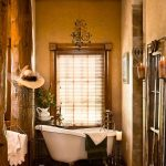 Bathroom, Wooden Floor, Brown Wall, White Tub With Clawfoot,