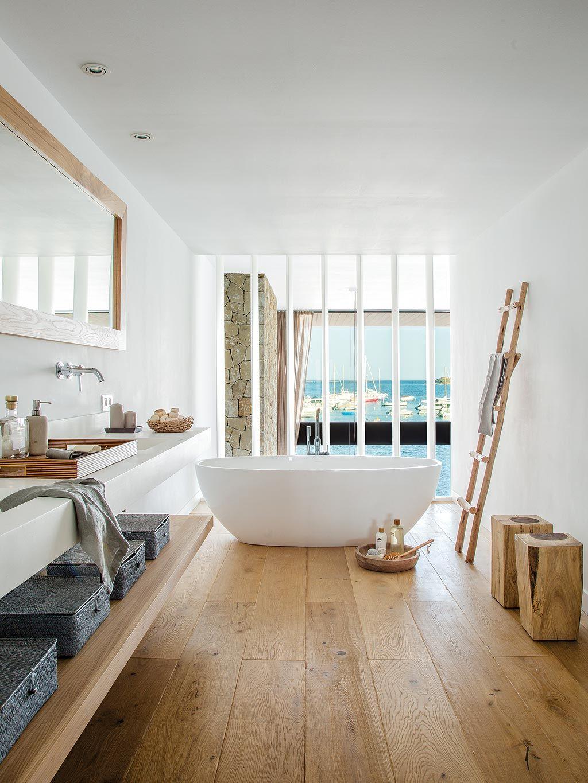 bathroom, wooden floor, white wall, white grid, white floating vanity table, wooden floating shelves, wooden ottoman, white tub