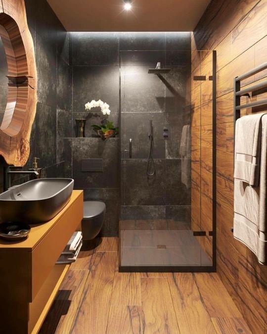 bathroom, wooden floor, wooden wall, black marble wall, black sink, wooden floating vanity, wooden framed mirror