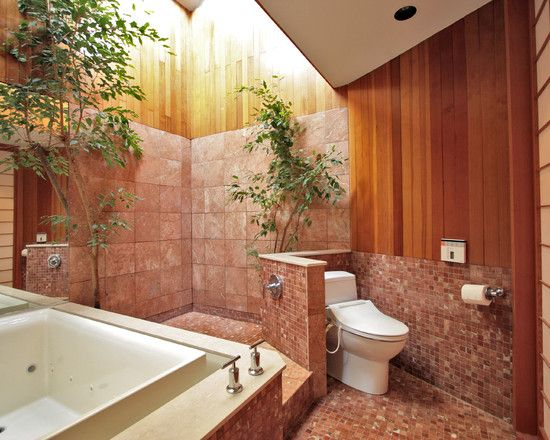 bathroom, wooden upper wall, pink tiles on bottomwall, white toilet, white tub