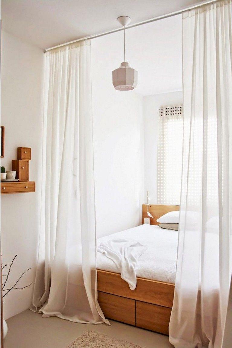 bed inside a nook, wooden bed platform, white pendant, wooden headboard, wooden floating shelves