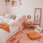 Bedroom, Pink Rug, Rattan Side Table, White Bed, Orange Pillow, Mirror