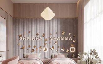 bedroom, pink wall, grey headboard, white lantern pendants, white round coffee tbale, white sofa, white rug
