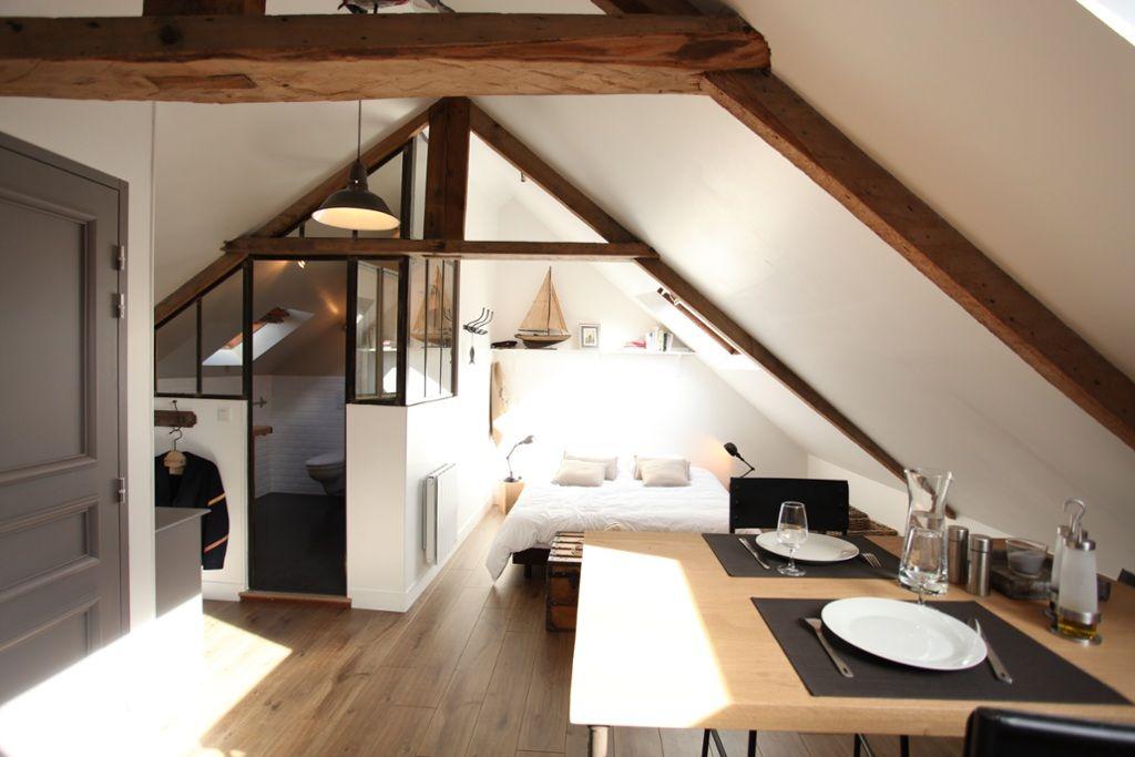 bedroom, vaulted ceiling, wooden beams, bed, bathroom, wooden table