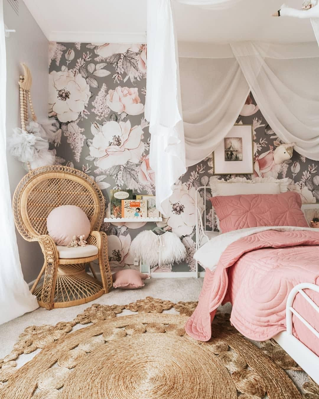 bedroom, white floor, rattan rug, flowery accent wall, white wall, white canopy, white bed iron platform, rattan chair