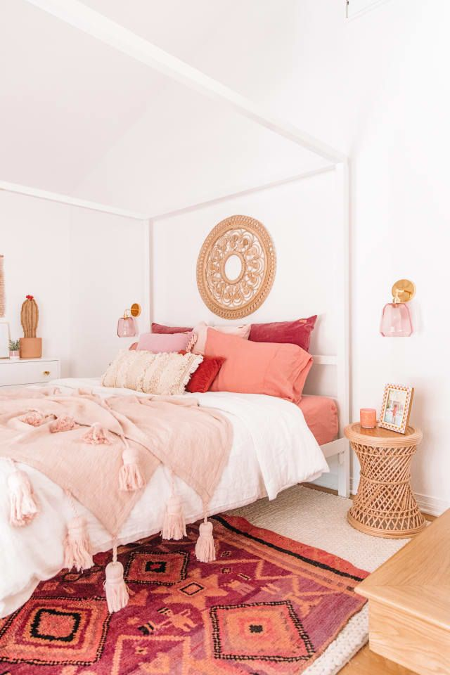 bedroom, white rug, patterned rug, white bed frame, rattan side table, whtie cabinet, wooden table