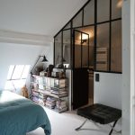 Bedroom, White Wooden Floor, White Wall, Vaulted Ceiling, Glass Wall, Black Stool, Blue Bed,