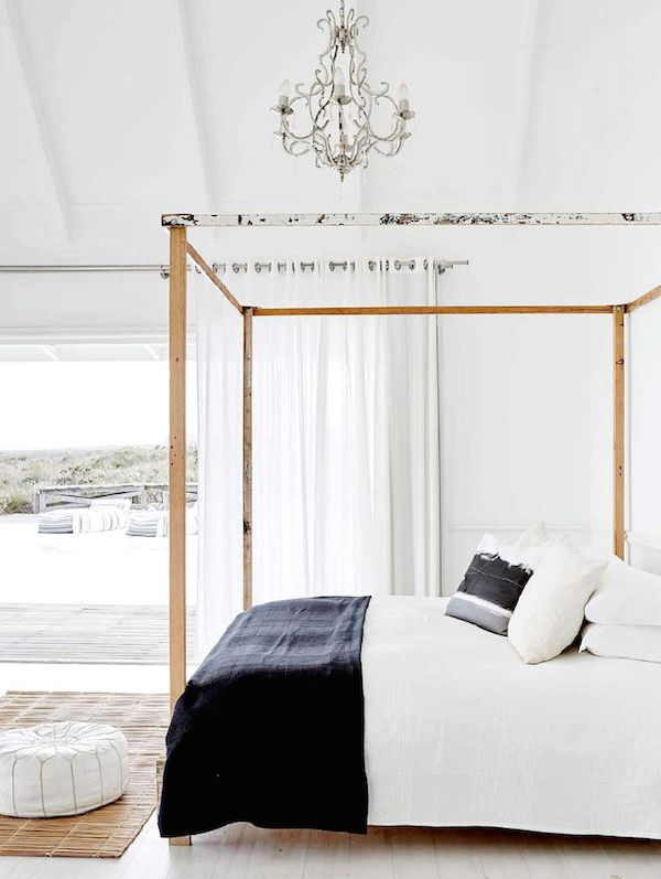 bedroom, white wooden platform, white wall, wooden bed platform, chandelier