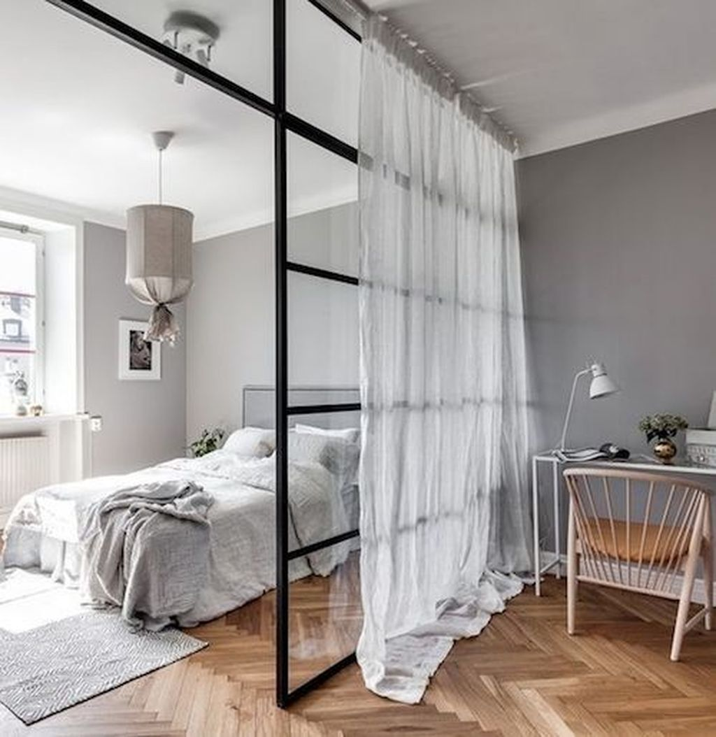 bedroom, wooden floor, grey wall, white ceiling, white curtain, white bed, white rug, white table, rattan chair