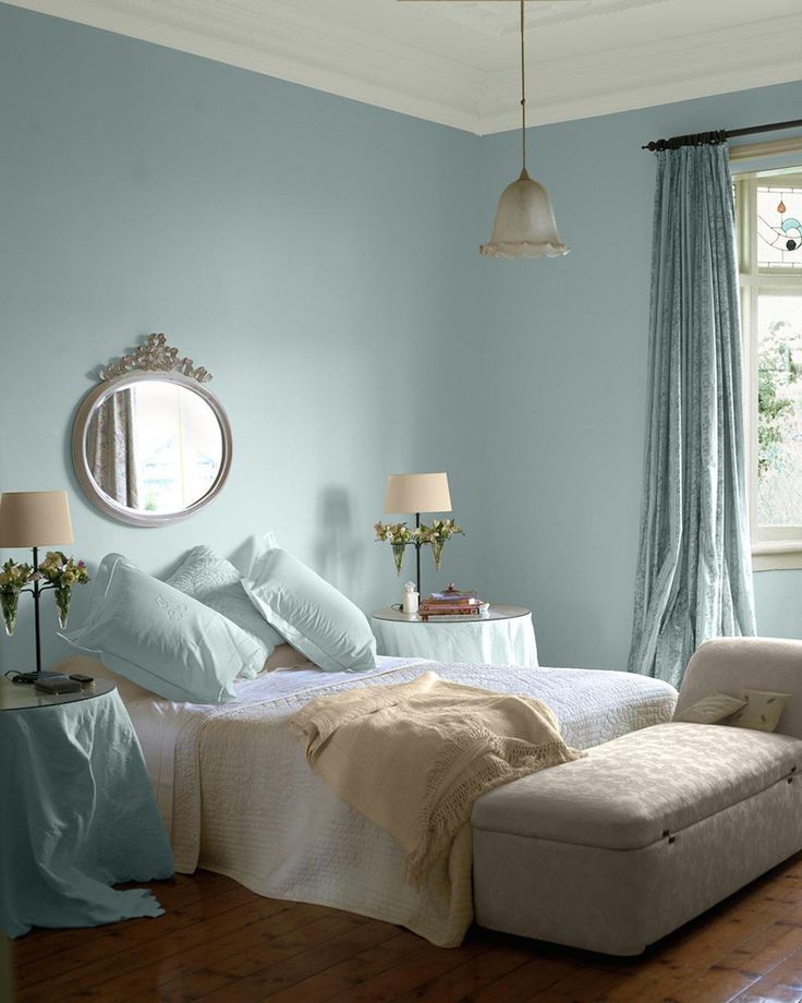 bedroom, wooden floor, white blue wall, white bed, side tables, lounge chairr