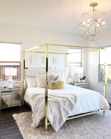 bedroom, wooden floor, white wall, round chandelier, white bed, golden frames, mirror side cabinet