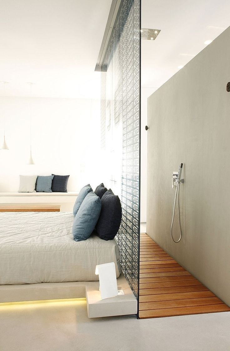 bedroom, wooden floor, white wall, shower area, glass partition, white bed, white window nook