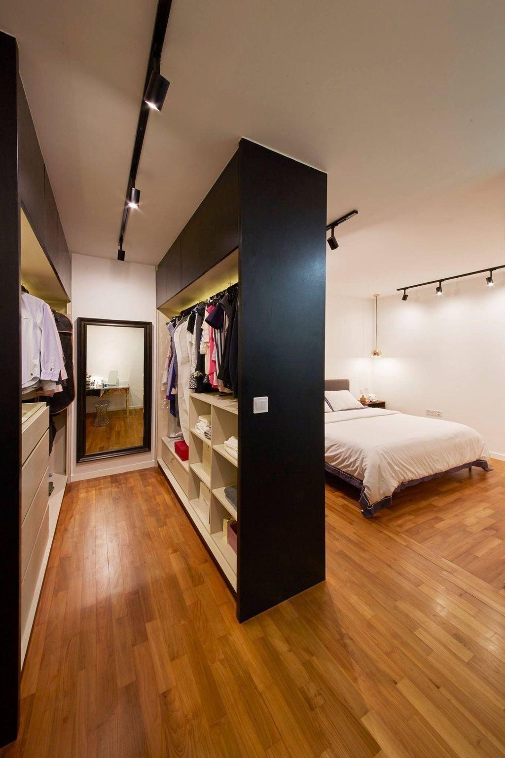 bedroom, wooden floor, white wall, white bed, black white cabinet, black framed mirror