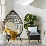 Black Rattan Chair, Egg Shape, White Wooden Wall