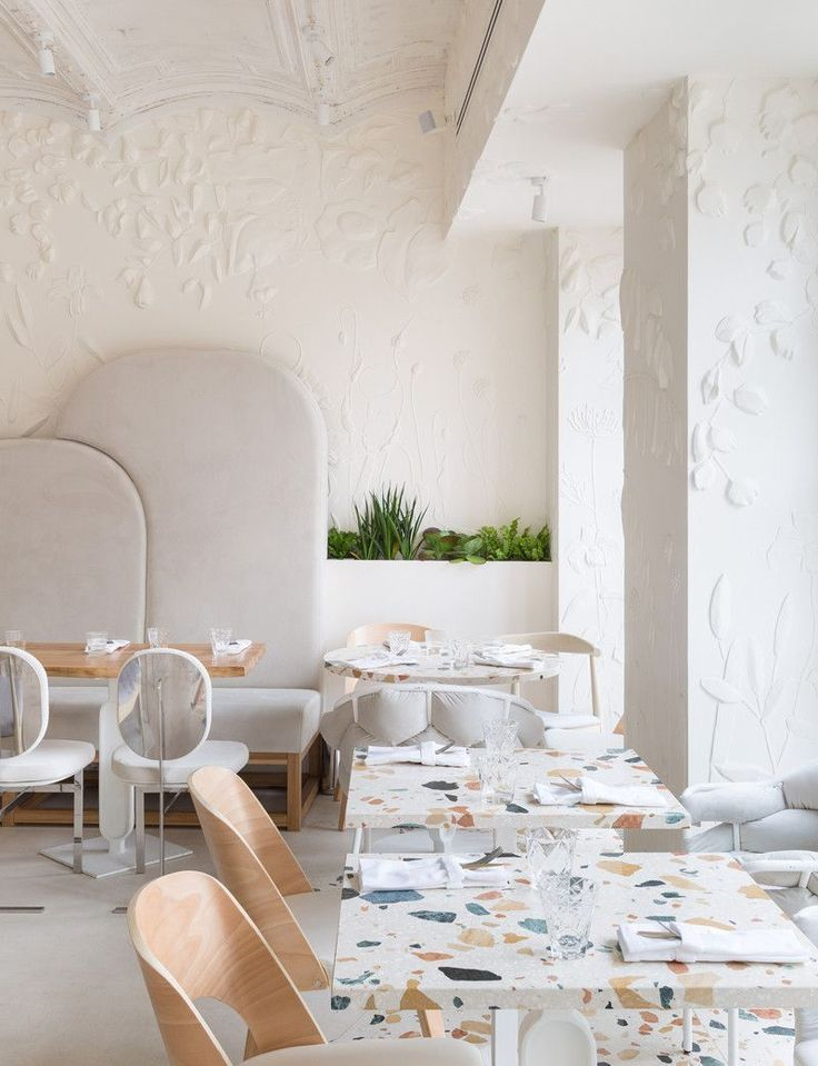 cafe, terrazzo dining tables, white bench, white chairs, white wall