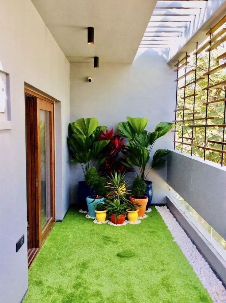 colorful plant pots, green grass floor
