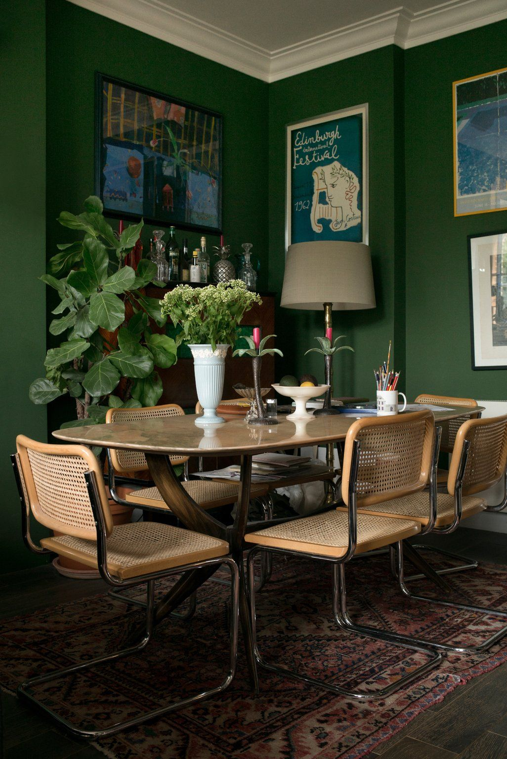 dining, patterned rug, wooden chairs, brown marble dining table, green wall