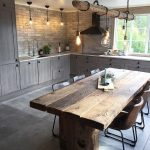 Dining Room, Grey Floor, Brown Subway Wall, Wooden Table, Black Chairs, Wooden Rod With Pendants