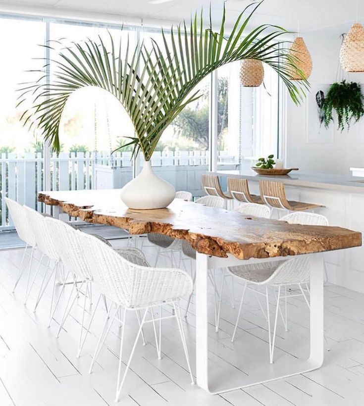 dining room, white wooden floor, wooden slab table, white rattan chairs, white wall
