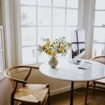 Dining Room, Wooden Floor, White Round Table, Wooden Chairs With Rattan Seat, White Framed Window