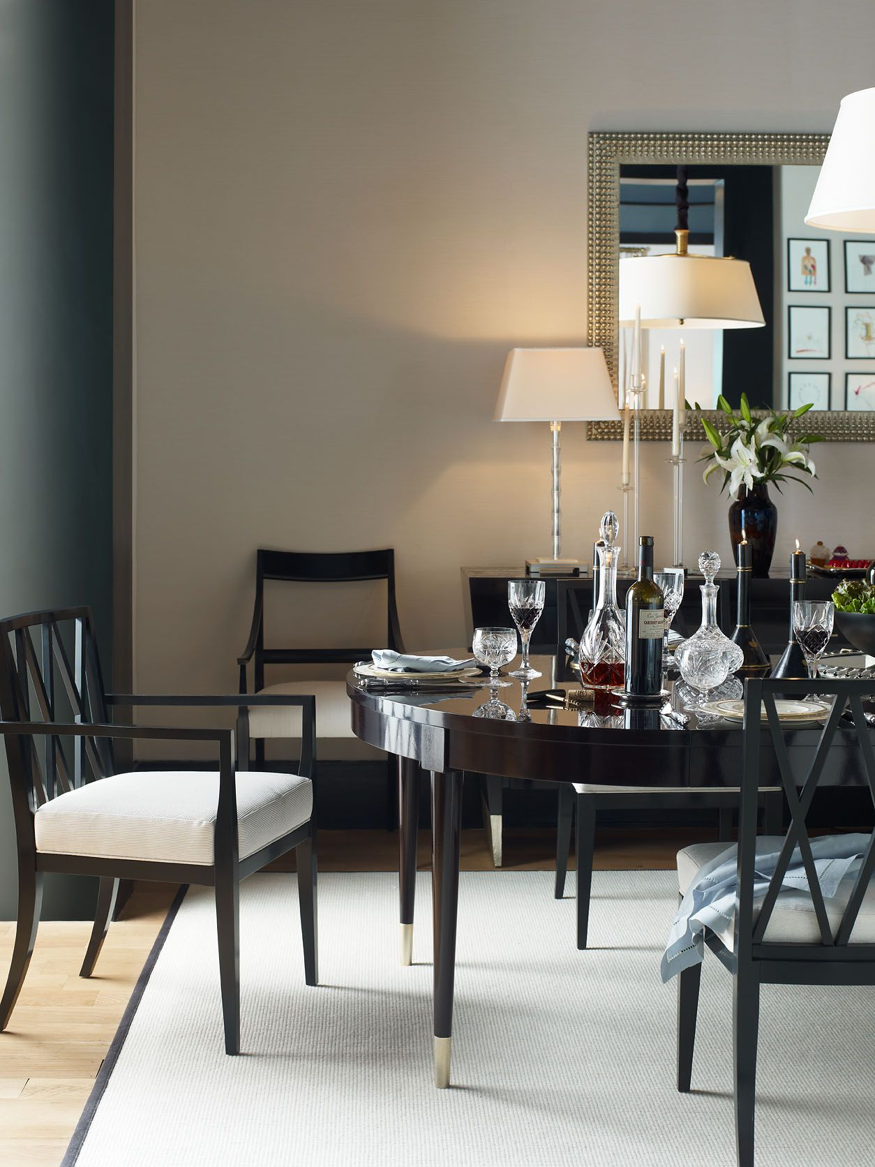 dining room, wooden floor, white wall, green wall, black dining set, black chairs white cushion, black console, white table lamp, white pendant