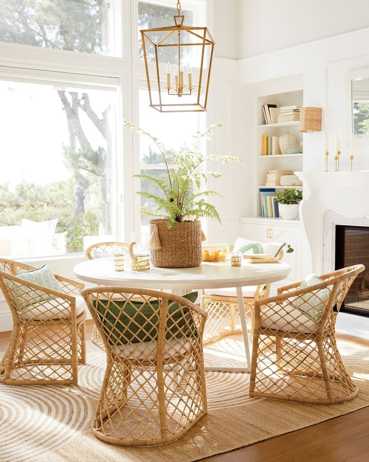 dining room, wooden floor, white wall, nook shelves, white round table, rattan chairs,