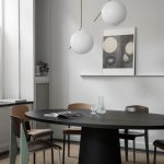 Dining Room, Wooden Floor, White Wall, White Nook Shelves, White Pendants, Black Dining Table, Chairs