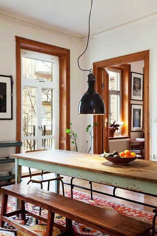 dining room, wooden floor, white wall, wooden dining table, black pendant, wooden bench
