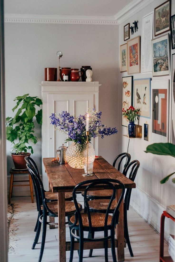 dining room, wooden floor, white wall, wooden table, black wooden chair with rattan seat